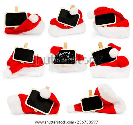 Santa Cap collection with blackboard sign isolated on white - stock photo