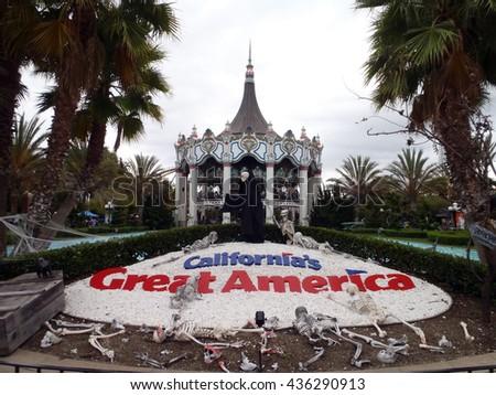 SANTA CLARA - AUGUST 7:California's Great America Halloween Theme entrance with Merry-go-round behind it on  August 7, 2010 Great America Park Santa Clara, California. - stock photo