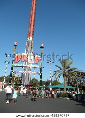 SANTA CLARA - AUGUST 7: People wait in line for Drop Tower Scream Zone at Great America Theme Park on  August 7, 2010 Great America Park Santa Clara, California. - stock photo