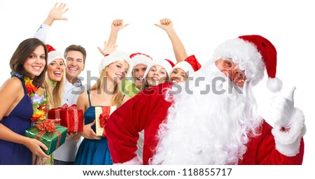 Santa claus and a group  of happy people. Christmas party. - stock photo