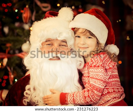 Santa Claus and child at home against Christmas tree. Family holiday concept - stock photo