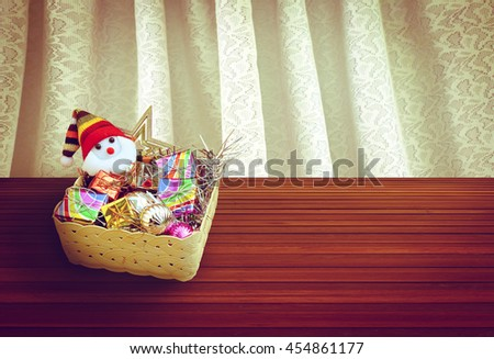 Santa Claus and christmas decoration in basket with white drapery - stock photo