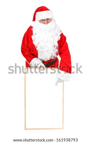 Santa claus and empty white board  - stock photo