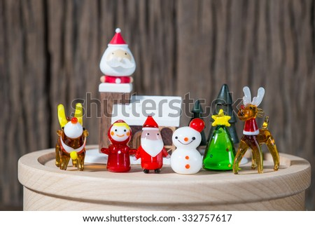 Santa-Claus and family in wood house - stock photo