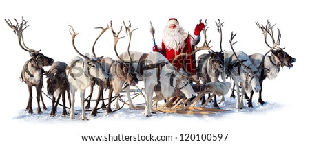 Santa Claus are near his deer in harness on the white background. He welcomes you and is waving his hand. - stock photo