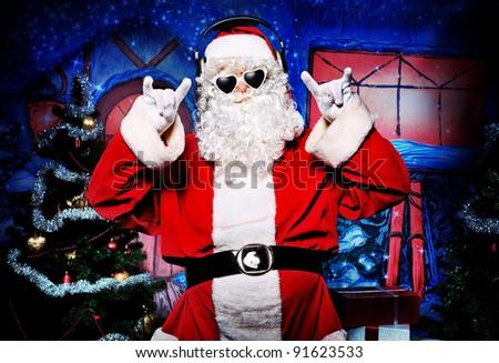 Santa Claus at a Christmas party. - stock photo