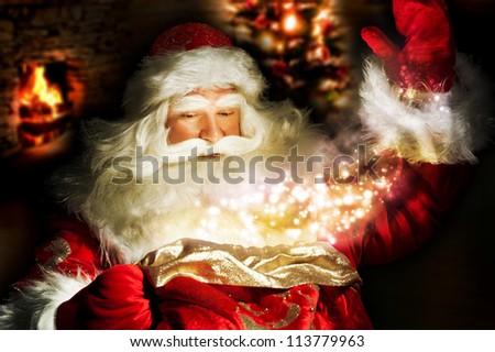 Santa Claus at home at night making magic - stock photo