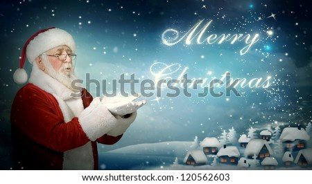 Santa Claus blowing ??Merry Christmas from snow to little town - stock photo