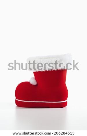 Santa Claus boot on white background - stock photo