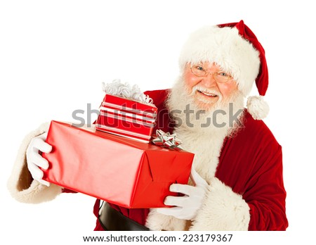 Santa Claus: Cheerful With Small Stack Of Gifts - stock photo