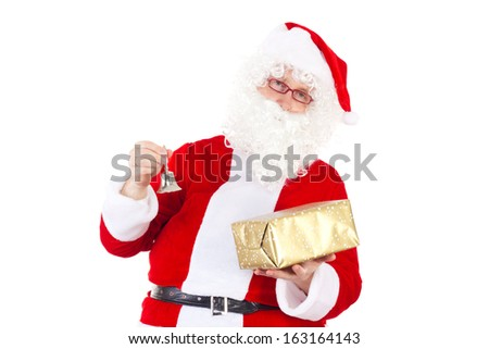 Santa Claus chimes the bell due to Christmas Eve - stock photo