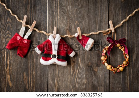 Santa Claus clothes and jewelry on the clothesline - stock photo