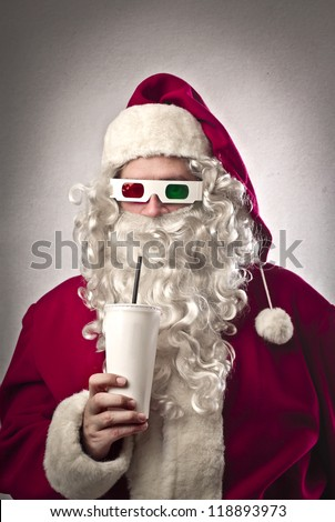 Santa Claus drinking a soda and wearing tridimensional glasses - stock photo