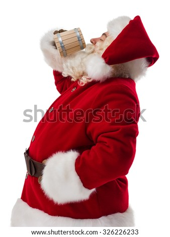 Santa Claus drinking beer from wooden cup. Portrait Isolated on White Background - stock photo