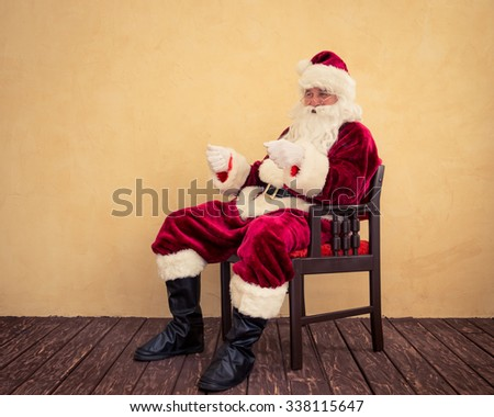 Santa Claus drive in imaginary sleigh. Christmas miracle concept - stock photo