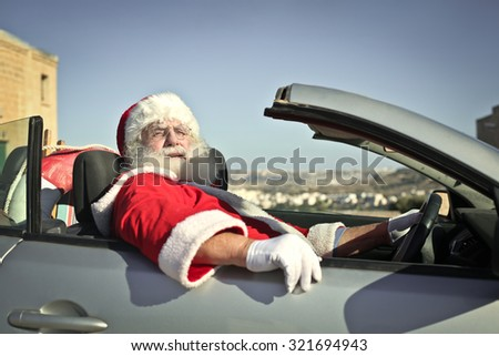 Santa Claus driving his car - stock photo