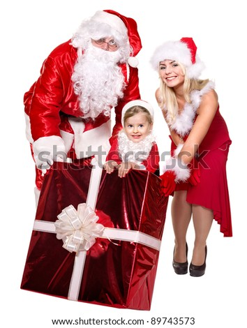 Santa claus family with child holding  gift box..  Isolated. - stock photo