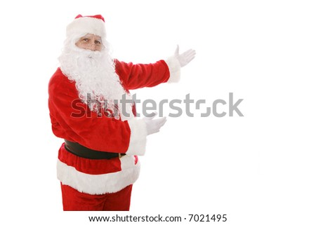 Santa Claus gesturing toward an area of copy space.  Isolated design element. - stock photo