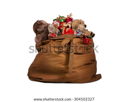 Santa Claus gift bag full of toys and gifts isolated over white background - stock photo