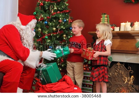 Santa Claus gives Christmas gifts to children - stock photo