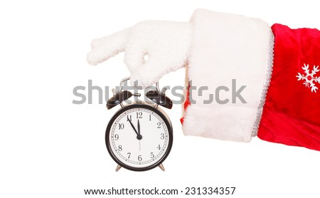Santa Claus Hand Holding a Alarm Clock - stock photo