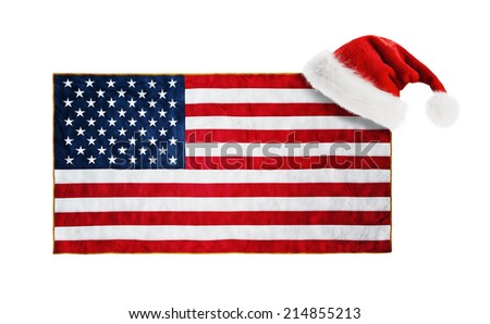 Santa Claus hat hung on the USA flag - stock photo