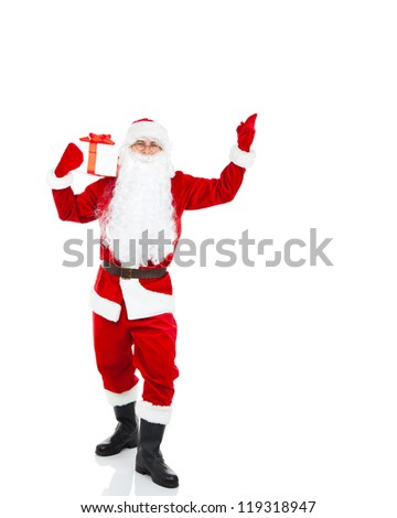 Santa Claus hold gift box present Banner point finger glove up at blank empty copy space for Text isolated over white background, concept of christmas new year sale shopping - stock photo
