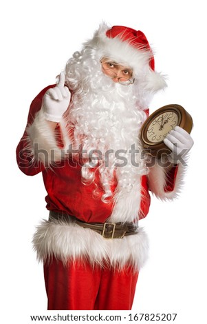 Santa Claus holding a clock showing several  minutes to midnight - stock photo