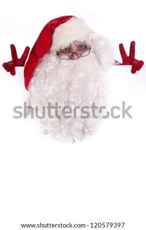 Santa Claus holding a white sign and showing a victory sign - stock photo