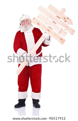 Santa Claus holding blank wooden sign as road sign, isolated on white background - stock photo