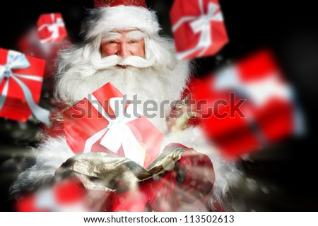 Santa Claus holding his bag and smiling. Gift boxes are flying from his sack - stock photo