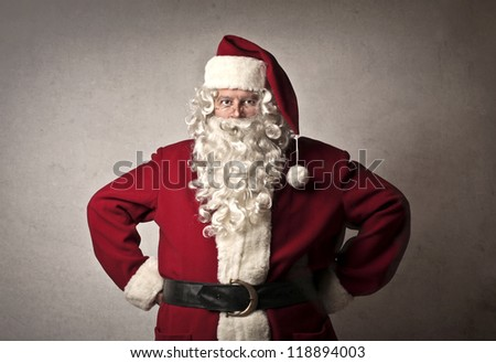 Santa Claus holding his hands on his tips - stock photo