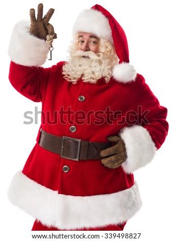 Santa Claus holding keys Closeup Portrait Isolated on White Background - stock photo