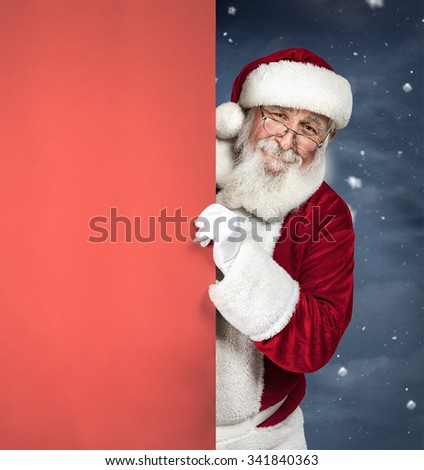 Santa Claus holding red blank sign, Christmas advertising - stock photo