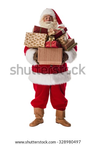 Santa Claus holding stack of gift boxes Full-Length Portrait - stock photo