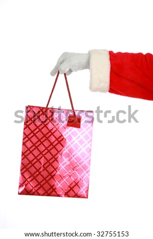 santa claus holds a red christmas gift bag  isolated on white with room for your text - stock photo