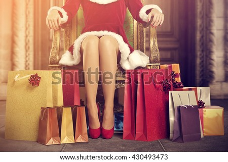 santa claus home interior with old big doors and closeup of few bags  - stock photo
