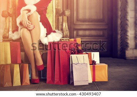 santa claus home interior with old big doors and woman and few xmas bags  - stock photo
