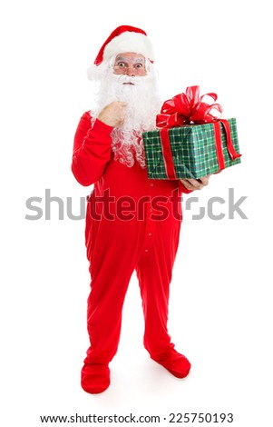 Santa Claus in his pajamas, surprised by a Christmas gift for him.  Full body isolated.   - stock photo