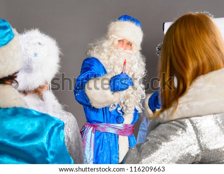 santa claus is conducting a business training - stock photo