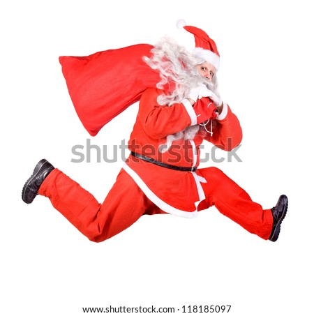 Santa Claus is running with a bag on white background - stock photo