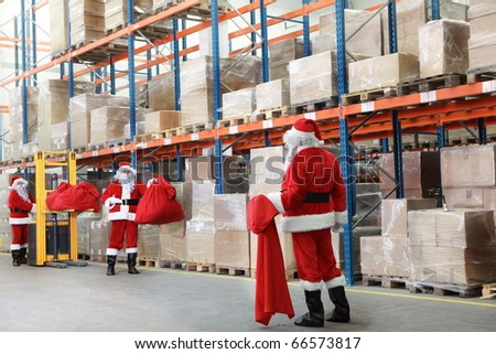 Santa claus looking for gifts in storehouse - stock photo