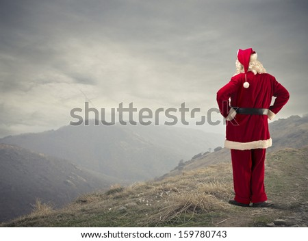 Santa Claus looking panorama in the mountain - stock photo