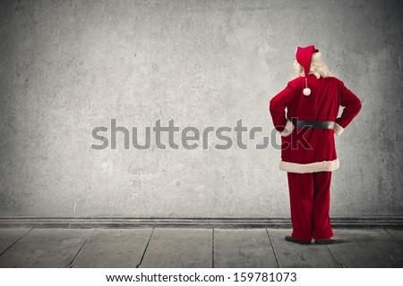 Santa Claus looking the wall - stock photo