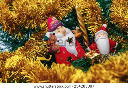 Santa Claus on snow background with Christmas Tree and toys - stock photo