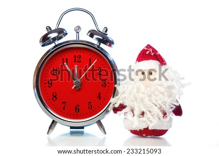 Santa Claus or Father Frost and vintage alarm clock with red dial on white background with reflection. Showing time five minutes before twelve midnight - stock photo