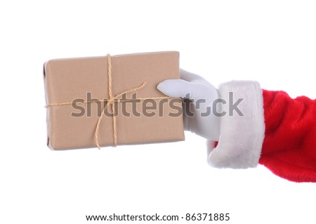 Santa Claus outstretched arm with a parcel in his hand. Horizontal format over a white background. - stock photo