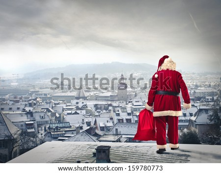 Santa Claus over the city with red sack - stock photo