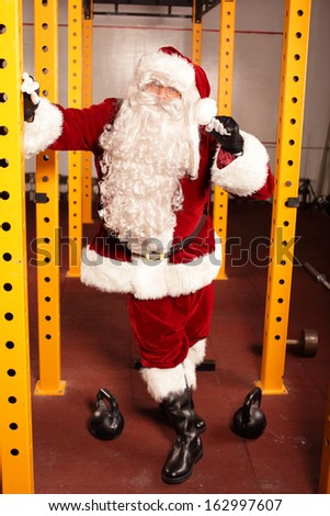 Santa Claus physical condition before Christmas training in gym - stock photo