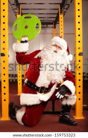 Santa Claus physical condition training before Christams time in gym - stock photo